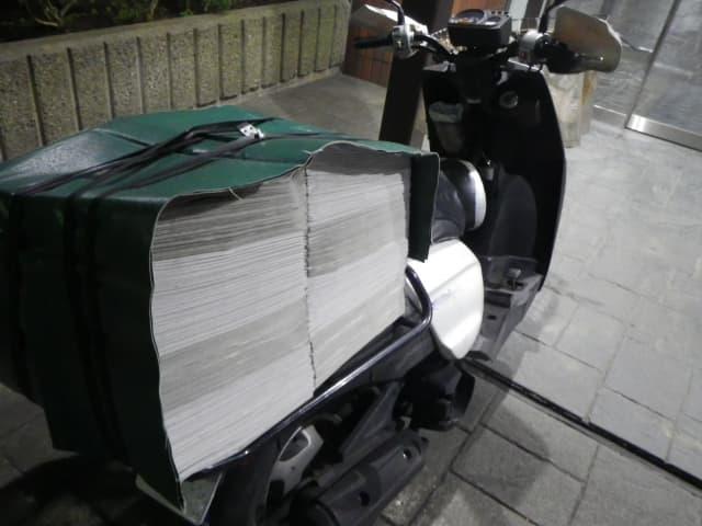 雨の日の新聞配達